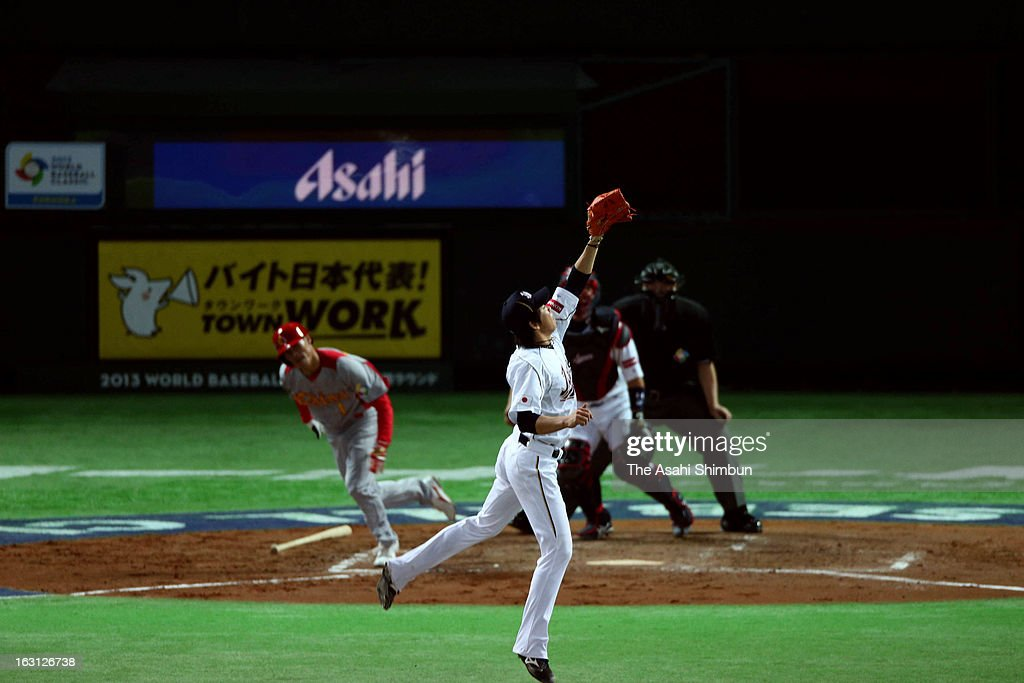 Starting pitcher <a gi-track='captionPersonalityLinkClicked' href=/galleries/search?phrase=Kenta+Maeda&family=editorial&specificpeople=10509788 ng-click='$event.stopPropagation()'>Kenta Maeda</a> #20 fields in the top of the fourth inning during the World Baseball Classic First Round Group A game between Japan and China at Fukuoka Yahoo! Japan Dome on March 3, 2013 in Fukuoka, Japan.