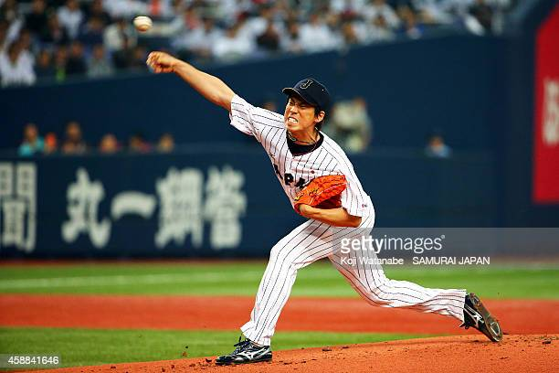 Starting Pitcher Kenta Maeda of Samurai Japan throws a pitch during in the top half of the first inning the game one of Samurai Japan and MLB All...