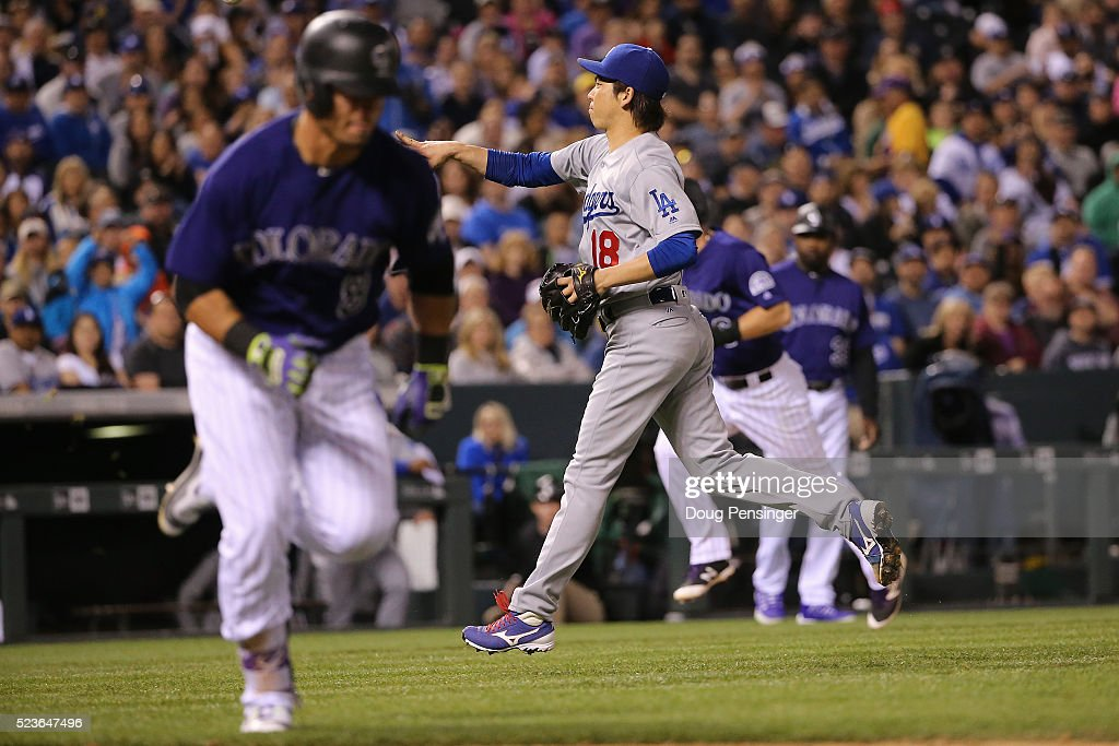 Starting pitcher <a gi-track='captionPersonalityLinkClicked' href=/galleries/search?phrase=Kenta+Maeda&family=editorial&specificpeople=10509788 ng-click='$event.stopPropagation()'>Kenta Maeda</a> #18 of the Los Angeles Dodgers fields a bases loaded gorund ball by <a gi-track='captionPersonalityLinkClicked' href=/galleries/search?phrase=Gerardo+Parra&family=editorial&specificpeople=4959447 ng-click='$event.stopPropagation()'>Gerardo Parra</a> #8 of the Colorado Rockies for a force out at home on <a gi-track='captionPersonalityLinkClicked' href=/galleries/search?phrase=DJ+LeMahieu&family=editorial&specificpeople=5940806 ng-click='$event.stopPropagation()'>DJ LeMahieu</a> #9 at Coors Field on April 23, 2016 in Denver, Colorado. The Dodgers defeated the Rockies 4-1.