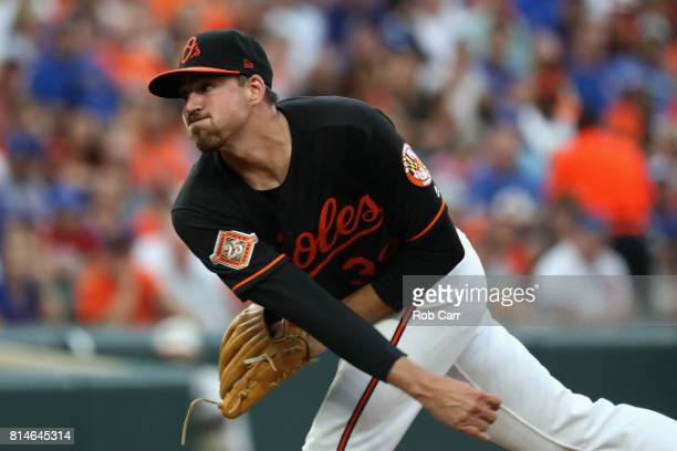 Starting pitcher Kevin Gausman of the Baltimore Orioles throws to a Chicago Cubs batter in the first inning at Oriole Park at Camden Yards on July 14...