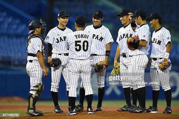 Starting pitcher Kohei Miyadai of Japan on the mound as infielders gather around in the top of first inning on the day 3 match between Japan and USA...