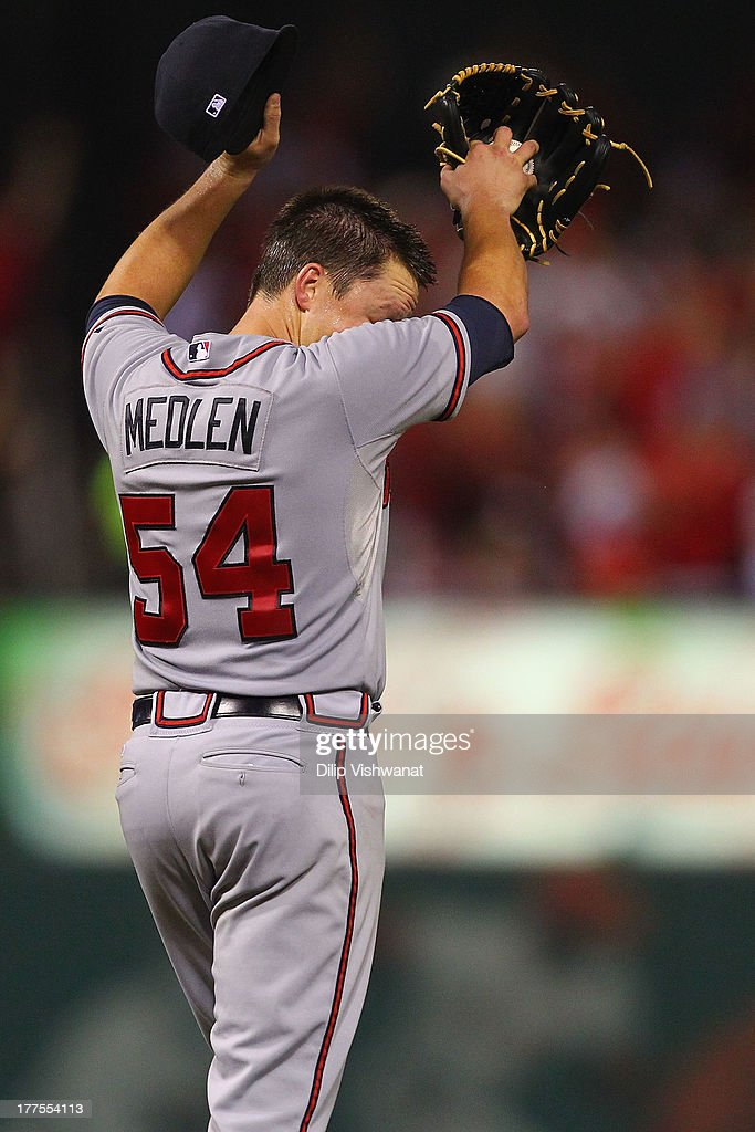 Starting pitcher <a gi-track='captionPersonalityLinkClicked' href=/galleries/search?phrase=Kris+Medlen&family=editorial&specificpeople=5743982 ng-click='$event.stopPropagation()'>Kris Medlen</a> #54 of the Atlanta Braves reacts after giving up a solo home run against the St. Louis Cardinals in the sixth inning at Busch Stadium on August 23, 2013 in St. Louis, Missouri. The Cardinals beat the Braves 3-1.