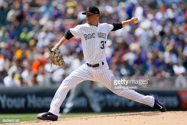 Starting pitcher Kyle Freeland of the Colorado Rockies delivers to home plate during the fourth inning against the Milwaukee Brewers at Coors Field...