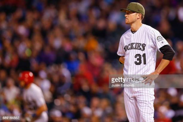 Starting pitcher Kyle Freeland of the Colorado Rockies reacts after giving up a home run to Tommy Pham of the St Louis Cardinals delivers to home...