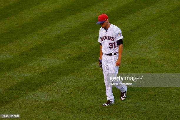 Starting pitcher Kyle Freeland of the Colorado Rockies walks off the field after being removed from the game in the sixth inning after giving up five...