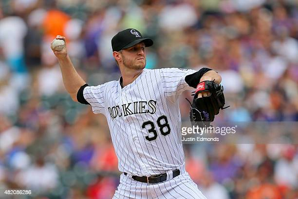 Starting pitcher Kyle Kendrick of the Colorado Rockies delivers to home plate during the first inning against the Cincinnati Reds at Coors Field on...