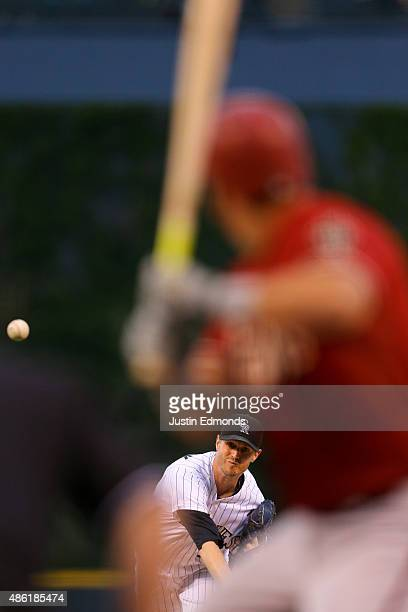Starting pitcher Kyle Kendrick of the Colorado Rockies delivers to home plate during the first inning against the Arizona Diamondbacks at Coors Field...