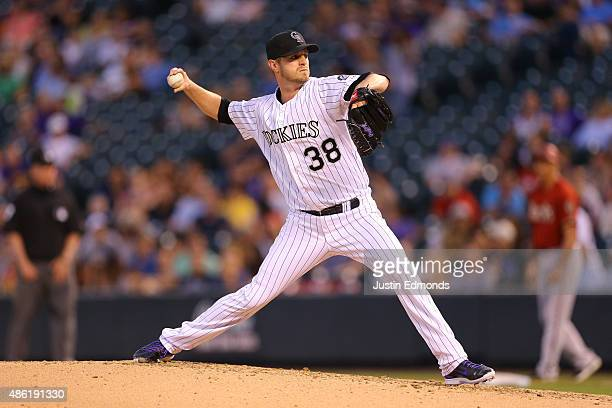 Starting pitcher Kyle Kendrick of the Colorado Rockies delivers to home plate during the third inning against the Arizona Diamondbacks at Coors Field...