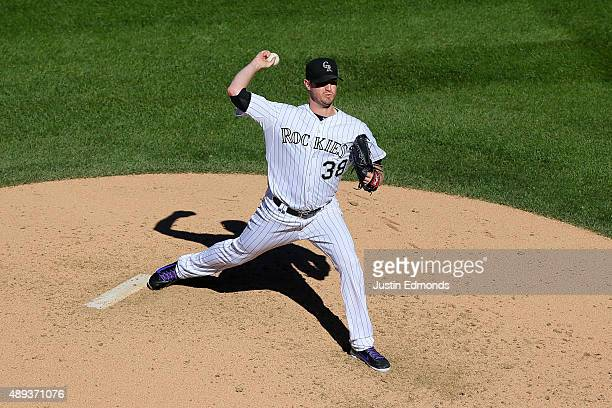 Starting pitcher Kyle Kendrick of the Colorado Rockies delivers to home plate during the fourth inning against the San Diego Padres at Coors Field on...