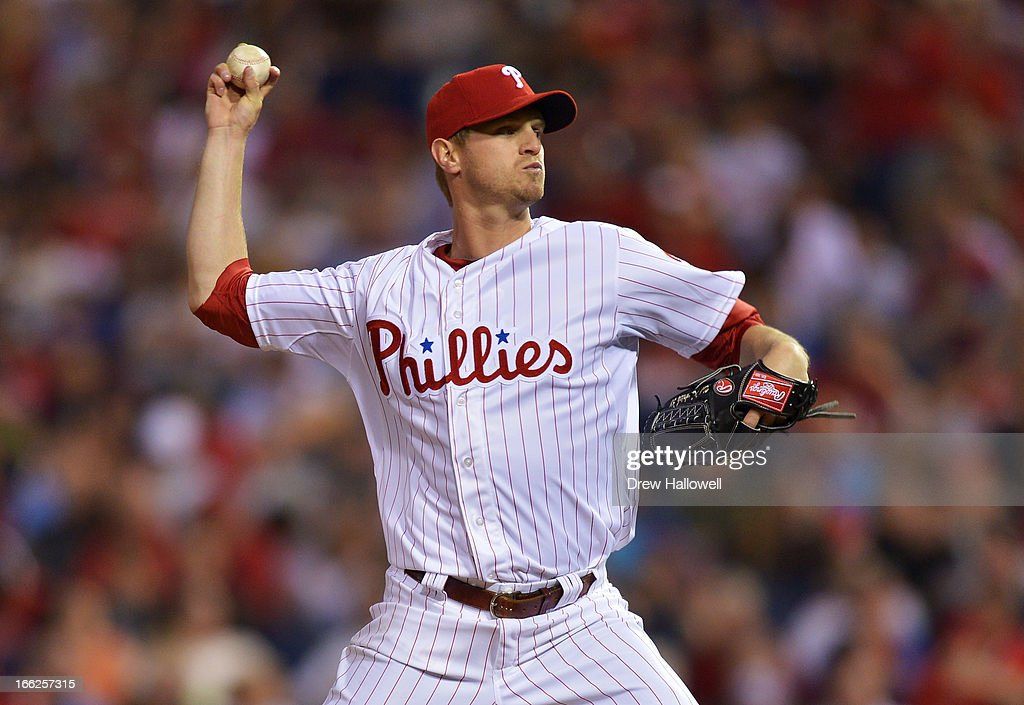 Starting pitcher <a gi-track='captionPersonalityLinkClicked' href=/galleries/search?phrase=Kyle+Kendrick&family=editorial&specificpeople=4365300 ng-click='$event.stopPropagation()'>Kyle Kendrick</a> #38 of the Philadelphia Phillies delivers a pitch during the game against the New York Mets at Citizens Bank Park on April 10, 2013 in Philadelphia, Pennsylvania.