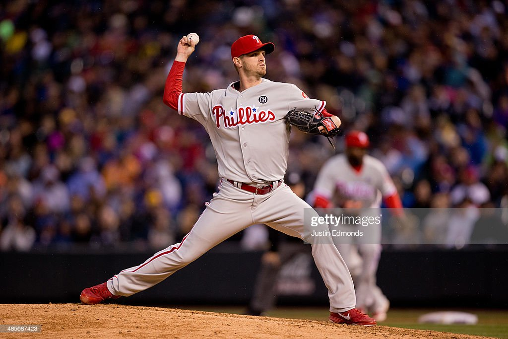 Starting pitcher <a gi-track='captionPersonalityLinkClicked' href=/galleries/search?phrase=Kyle+Kendrick&family=editorial&specificpeople=4365300 ng-click='$event.stopPropagation()'>Kyle Kendrick</a> #38 of the Philadelphia Phillies delivers to home plate during the fourth inning against the Colorado Rockies at Coors Field on April 19, 2014 in Denver, Colorado.