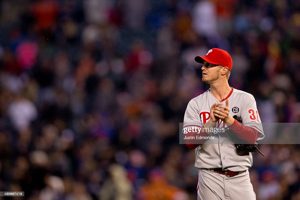 Starting pitcher <a gi-track='captionPersonalityLinkClicked' href=/galleries/search?phrase=Kyle+Kendrick&family=editorial&specificpeople=4365300 ng-click='$event.stopPropagation()'>Kyle Kendrick</a> #38 of the Philadelphia Phillies looks up at the scoreboard after giving up a home run to Justin Morneau #33 of the Colorado Rockies during the fourth inning at Coors Field on April 19, 2014 in Denver, Colorado.