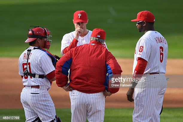 Starting pitcher Kyle Kendrick of the Philadelphia Phillies talks with Carlos Ruiz pitching coach Bob McClure and Ryan Howard of the Philadelphia...
