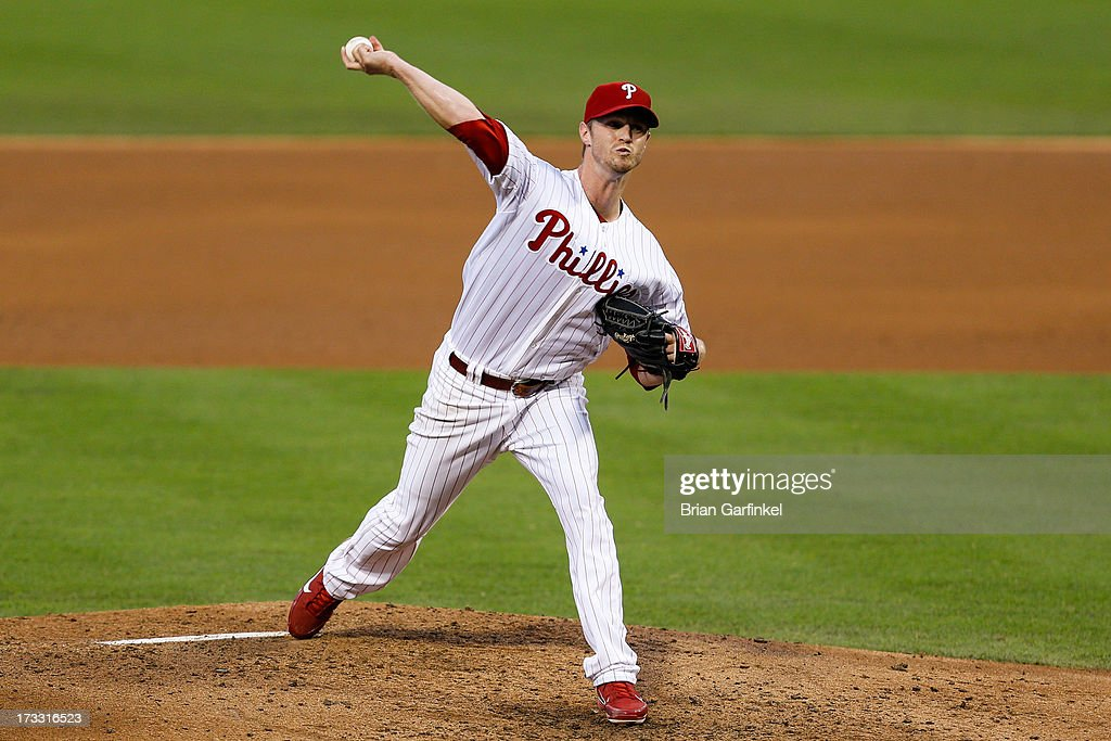 Starting pitcher <a gi-track='captionPersonalityLinkClicked' href=/galleries/search?phrase=Kyle+Kendrick&family=editorial&specificpeople=4365300 ng-click='$event.stopPropagation()'>Kyle Kendrick</a> #38 of the Philadelphia Phillies throws a pitch during the game against the Washington Nationals at Citizens Bank Park on July 11, 2013 in Philadelphia, Pennsylvania.