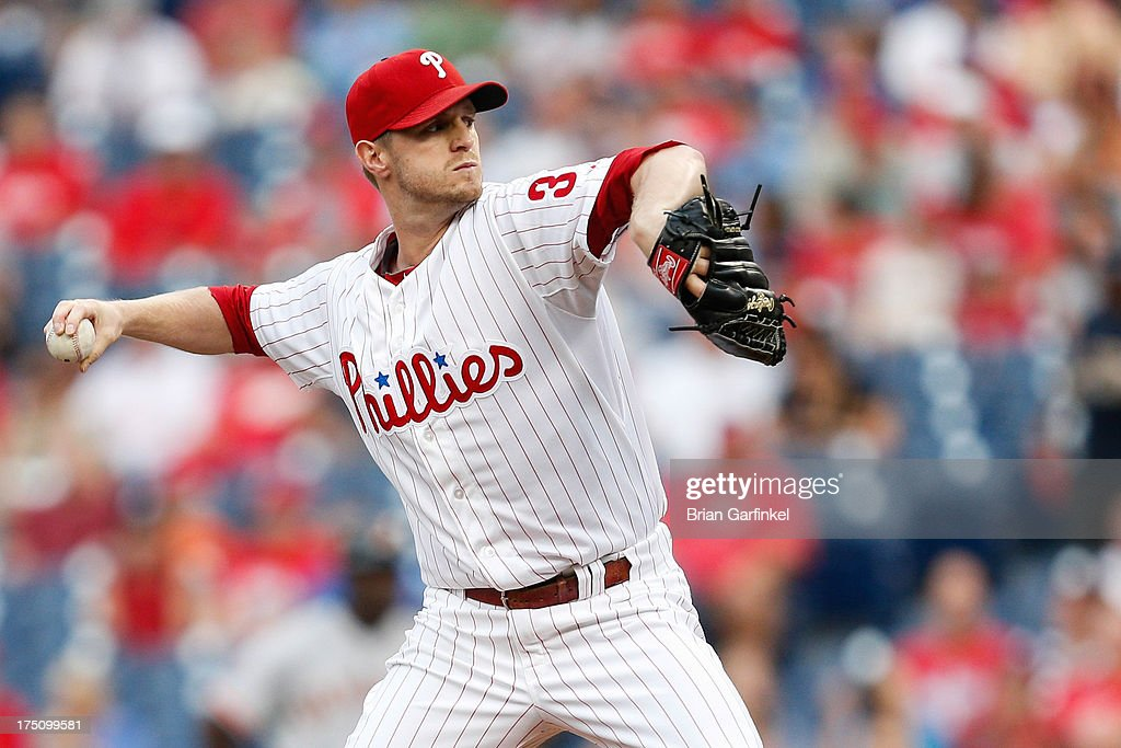Starting pitcher <a gi-track='captionPersonalityLinkClicked' href=/galleries/search?phrase=Kyle+Kendrick&family=editorial&specificpeople=4365300 ng-click='$event.stopPropagation()'>Kyle Kendrick</a> #38 of the Philadelphia Phillies throws a pitch during the game against the San Francisco Giants at Citizens Bank Park on July 31, 2013 in Philadelphia, Pennsylvania.
