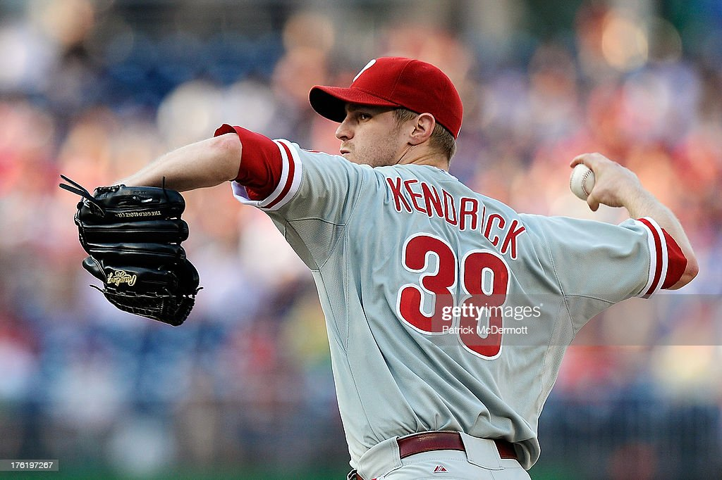 Starting pitcher <a gi-track='captionPersonalityLinkClicked' href=/galleries/search?phrase=Kyle+Kendrick&family=editorial&specificpeople=4365300 ng-click='$event.stopPropagation()'>Kyle Kendrick</a> #38 of the Philadelphia Phillies throws a pitch against the Washington Nationals during a game at Nationals Park on August 11, 2013 in Washington, DC.