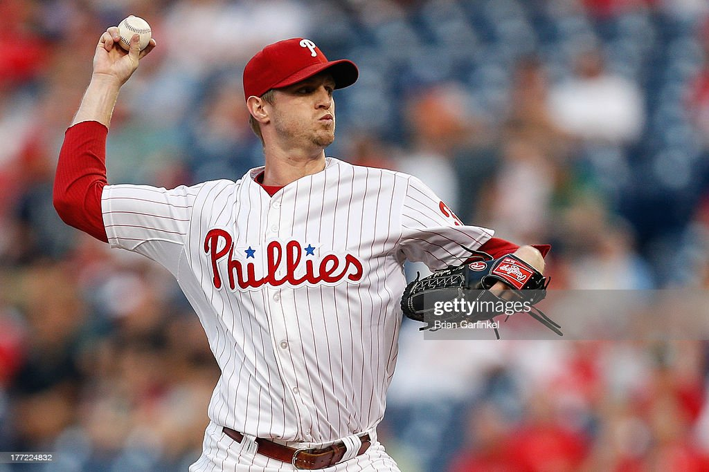 Starting pitcher <a gi-track='captionPersonalityLinkClicked' href=/galleries/search?phrase=Kyle+Kendrick&family=editorial&specificpeople=4365300 ng-click='$event.stopPropagation()'>Kyle Kendrick</a> #38 of the Philadelphia Phillies throws a pitch during the game against the Colorado Rockies at Citizens Bank Park on August 22, 2013 in Philadelphia, Pennsylvania.