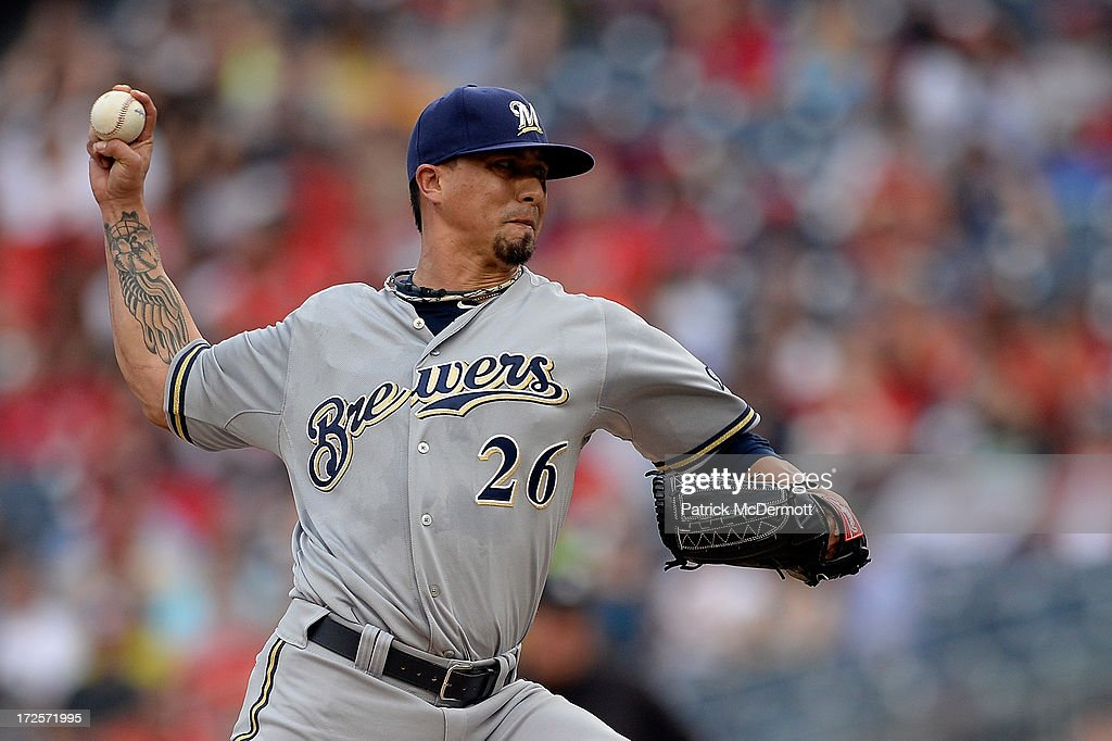 Starting pitcher <a gi-track='captionPersonalityLinkClicked' href=/galleries/search?phrase=Kyle+Lohse&family=editorial&specificpeople=218037 ng-click='$event.stopPropagation()'>Kyle Lohse</a> #26 of the Milwaukee Brewers throws a pitch in the second inning during a game against the Washington Nationals at Nationals Park on July 3, 2013 in Washington, DC.