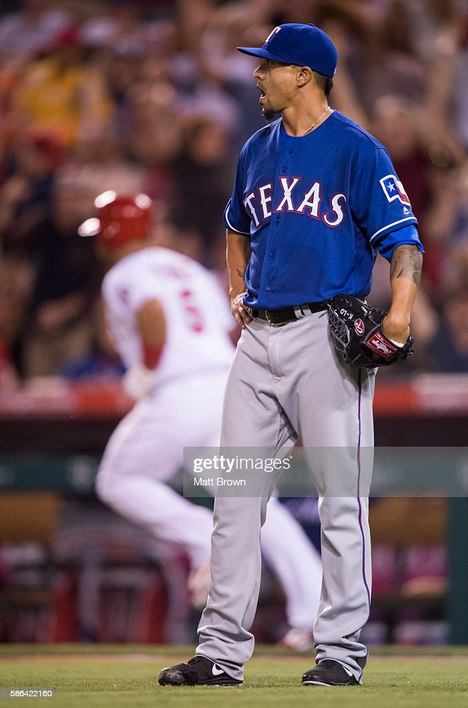 Starting pitcher Kyle Lohse #49 of the Texas Rangers reacts as Albert Pujols #5 of the Los Angeles Angels of Anaheim runs the bases after hitting a three-run home run during the fourth inning of the game at Angel Stadium of Anaheim on July 19, 2016 in Anaheim, California.