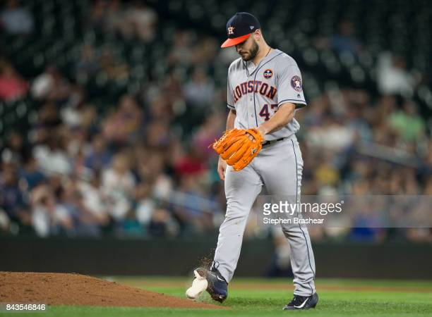 Starting pitcher Lance McCullers Jr of the Houston Astros kicks the rosin bag after giving up a run during the sixth inning of a game against the...