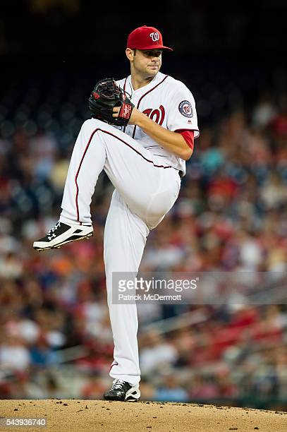 Starting pitcher Lucas Giolito of the Washington Nationals throws a pitch to a New York Mets batter in the second inning during his Major League...