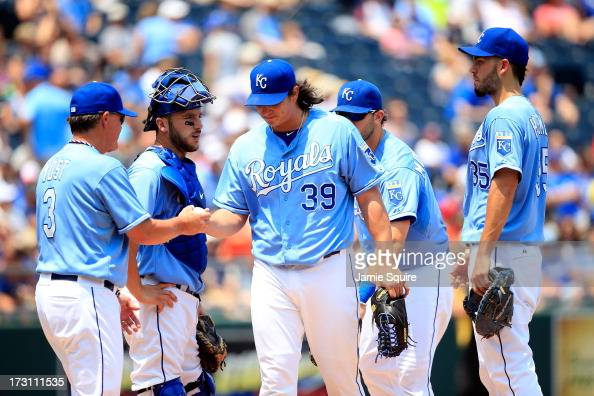 Starting pitcher Luis Mendoza of the Kansas City Royals is pulled by Manager manager Ned Yost during the top of the 2nd inning of the game against...