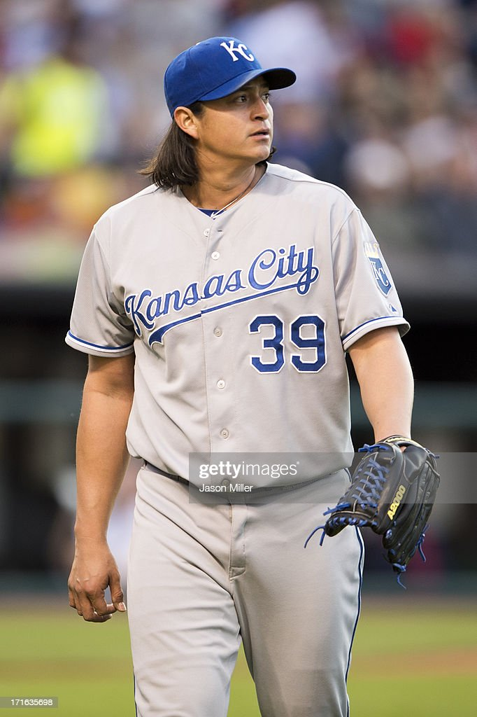 Starting pitcher Luis Mendoza of the Kansas City Royals walks back to the dugout after the fourth inning against the Cleveland Indians at Progressive...
