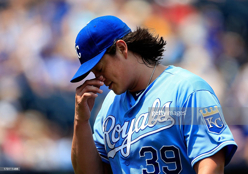 Starting pitcher Luis Mendoza of the Kansas City Royals walks off the field after being pulled at the top of the 2nd inning of the game against the...