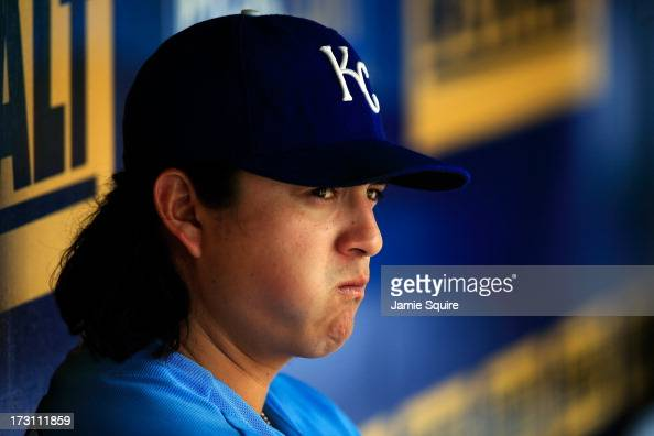Starting pitcher Luis Mendoza of the Kansas City Royals watches from the dugout during the game against the Oakland Athletics at Kauffman Stadium on...
