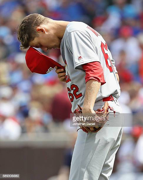 Starting pitcher Luke Weaver of the St Louis Cardinals takes a moment to himself before making his Major League debut against the Chicago Cubs at...