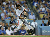 Starting pitcher Madison Bumgarner of the San Francisco Giants hits a two run home run in the third inning against the Los Angeles Dodgers in the...