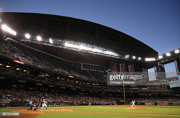 Starting pitcher Madison Bumgarner of the San Francisco Giants pitches against the Arizona Diamondbacks during the first inning of the MLB game at...