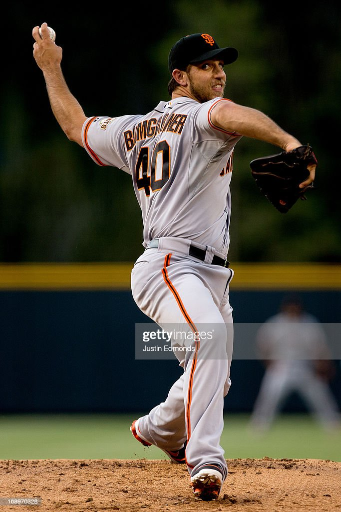 Starting pitcher <a gi-track='captionPersonalityLinkClicked' href=/galleries/search?phrase=Madison+Bumgarner&family=editorial&specificpeople=5974095 ng-click='$event.stopPropagation()'>Madison Bumgarner</a> #40 of the San Francisco Giants delivers to home plate during the first inning against the Colorado Rockies at Coors Field on May 17, 2013 in Denver, Colorado.