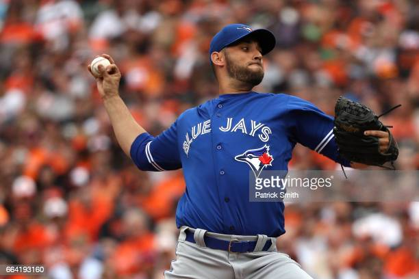 Starting pitcher Marco Estrada of the Toronto Blue Jays works the first inning against the Baltimore Orioles during their Opening Day game at Oriole...