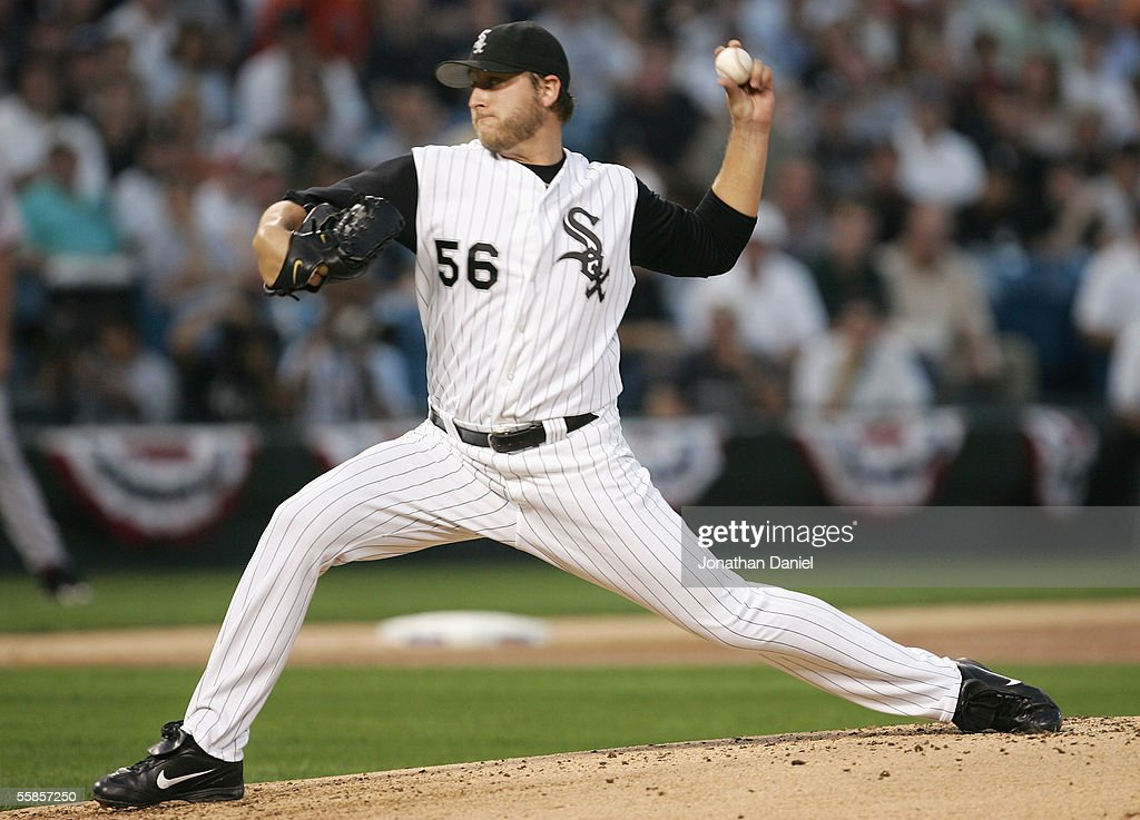 Starting pitcher Mark Buehrle of the Chicago White Sox throws a pitch against the Boston Red Sox during the first inning of Game Two of the American...