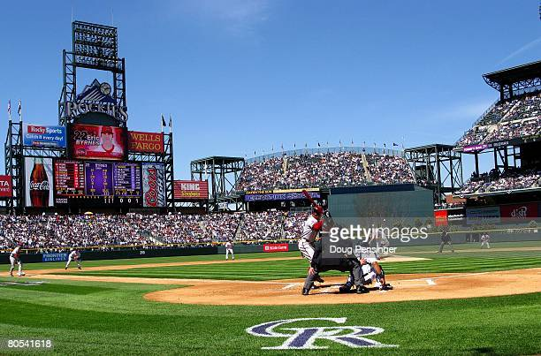 Starting pitcher Mark Redman of the Colorado Rockies delivers a pitch to Eric Byrnes of the Arizona Diamondbacks on opening day at Coors Field on...