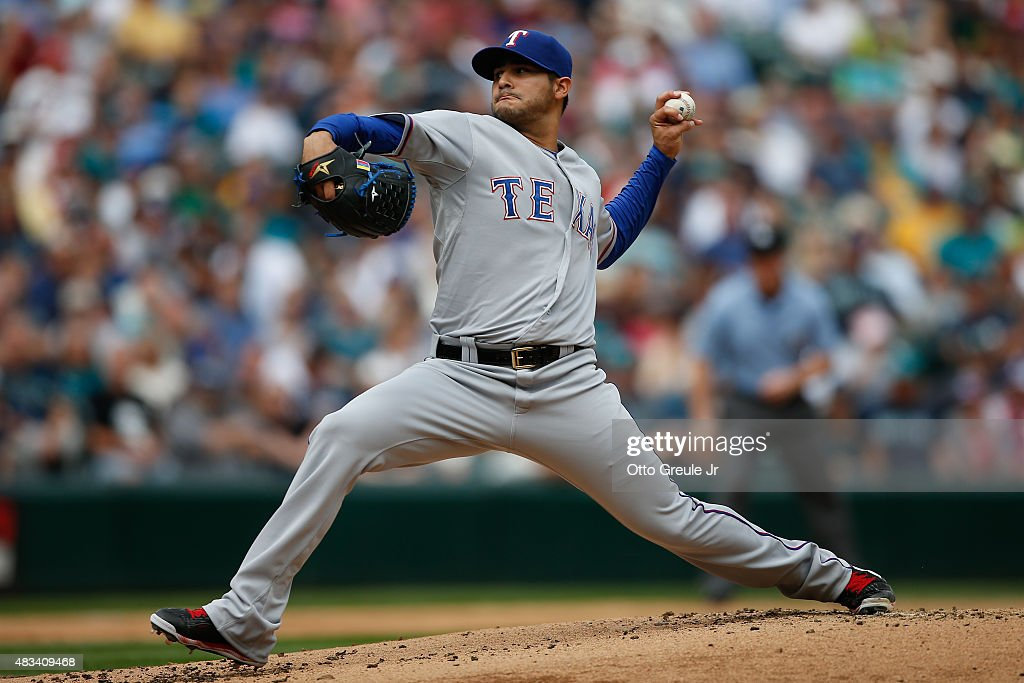 Starting pitcher Martin Perez #33 of the Texas Rangers pitches against the Seattle Mariners in the first inning at Safeco Field on August 8, 2015 in Seattle, Washington.