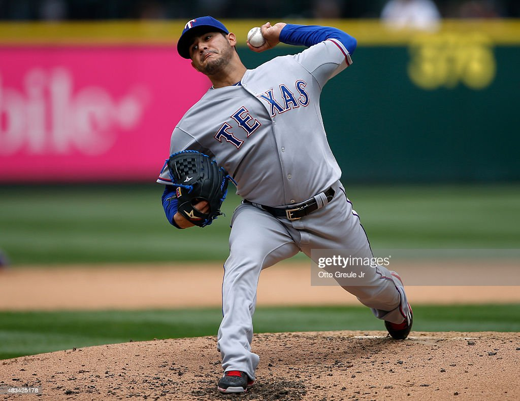 Starting pitcher Martin Perez #33 of the Texas Rangers pitches against the Seattle Mariners in the second inning at Safeco Field on August 8, 2015 in Seattle, Washington.