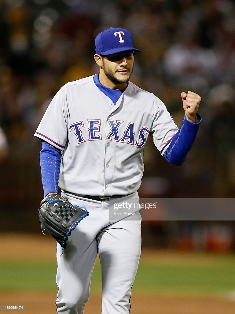 Starting pitcher Martin Perez #33 of the Texas Rangers reacts after Elvis Andrus #1 of the Texas Rangers made a nice play to end the first inning of their game against the Oakland Athletics at O.co Coliseum on September 22, 2015 in Oakland, California.