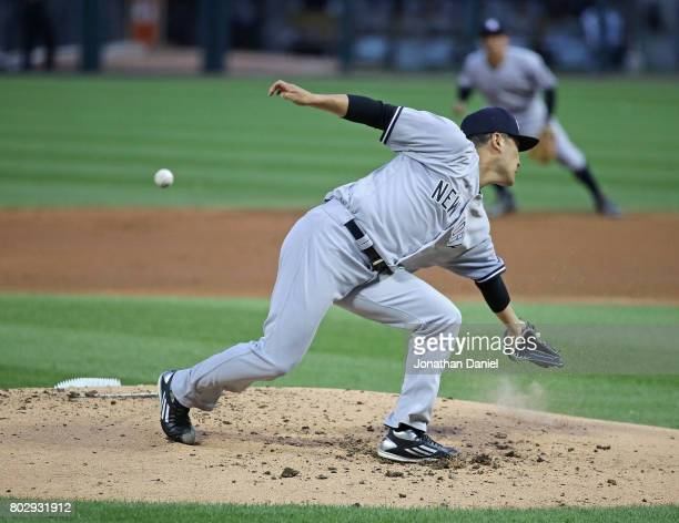 Starting pitcher Masahiro Tanaka of the New York Yankees lunges for a ball hit by Melky Cabrera of the Chicago White Sox in the 1st inning at...