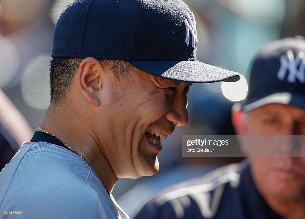 Starting pitcher Masahiro Tanaka of the New York Yankees smiles in the dugout after completing seven innings against the Seattle Mariners at Safeco...