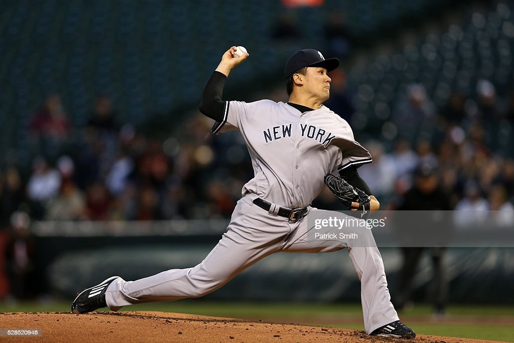Starting pitcher <a gi-track='captionPersonalityLinkClicked' href=/galleries/search?phrase=Masahiro+Tanaka&family=editorial&specificpeople=5492836 ng-click='$event.stopPropagation()'>Masahiro Tanaka</a> #19 of the New York Yankees works the first inning against the Baltimore Orioles at Oriole Park at Camden Yards on May 5, 2016 in Baltimore, Maryland.