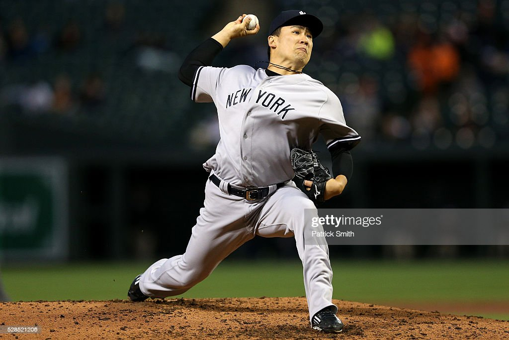 Starting pitcher <a gi-track='captionPersonalityLinkClicked' href=/galleries/search?phrase=Masahiro+Tanaka&family=editorial&specificpeople=5492836 ng-click='$event.stopPropagation()'>Masahiro Tanaka</a> #19 of the New York Yankees works the third inning against the Baltimore Orioles at Oriole Park at Camden Yards on May 5, 2016 in Baltimore, Maryland.