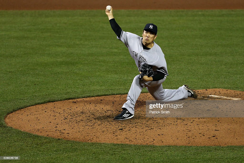 Starting pitcher <a gi-track='captionPersonalityLinkClicked' href=/galleries/search?phrase=Masahiro+Tanaka&family=editorial&specificpeople=5492836 ng-click='$event.stopPropagation()'>Masahiro Tanaka</a> #19 of the New York Yankees works the fifth inning against the Baltimore Orioles at Oriole Park at Camden Yards on May 5, 2016 in Baltimore, Maryland.