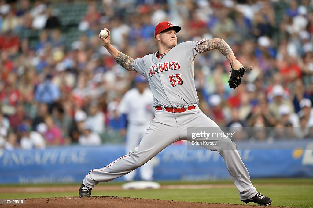 Starting pitcher <a gi-track='captionPersonalityLinkClicked' href=/galleries/search?phrase=Mat+Latos&family=editorial&specificpeople=5743563 ng-click='$event.stopPropagation()'>Mat Latos</a> #55 of the Cincinnati Reds delivers during the first inning against the Chicago Cubs at Wrigley Field on August 12, 2013 in Chicago, Illinois.