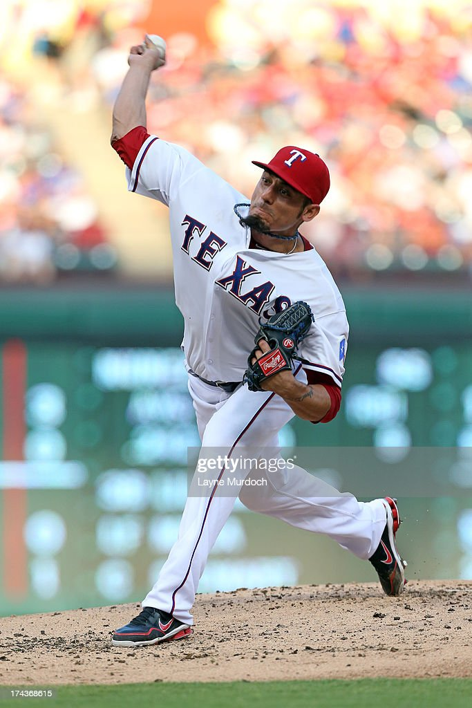 Starting pitcher Matt Garza #22 of the Texas Rangers is pitches in the first inning against the New York Yankees on July 24, 2013 at the Rangers Ballpark in Arlington in Arlington, Texas.