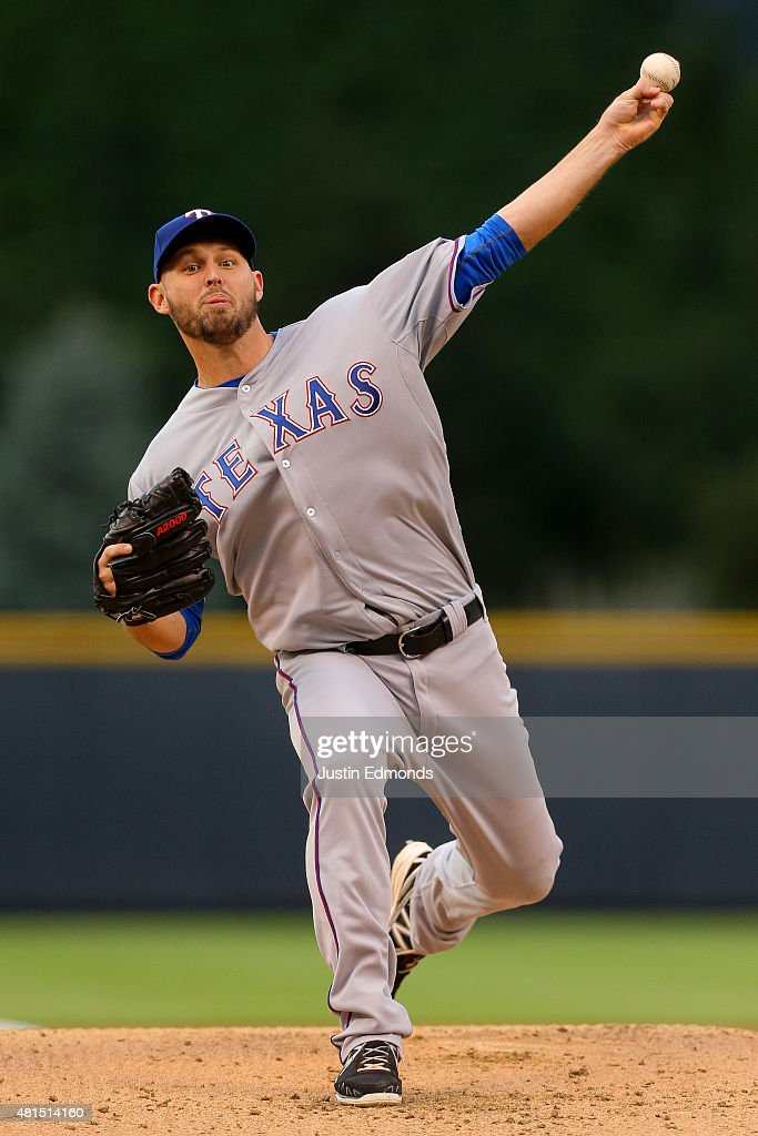 Starting pitcher <a gi-track='captionPersonalityLinkClicked' href=/galleries/search?phrase=Matt+Harrison&family=editorial&specificpeople=4171692 ng-click='$event.stopPropagation()'>Matt Harrison</a> #54 of the Texas Rangers delivers to home plate in the first inning against the Colorado Rockies during Interleague play at Coors Field on July 21, 2015 in Denver, Colorado.