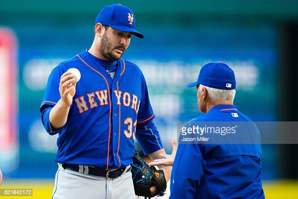 Starting pitcher Matt Harvey hands the ball to manager Terry Collins of the New York Mets as he leaves the game during the sixth inning after giving...
