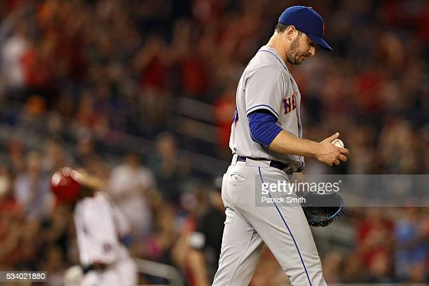 Starting pitcher Matt Harvey of the New York Mets looks on after allowing a two run home run by Daniel Murphy of the Washington Nationals during the...