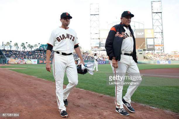 Starting pitcher Matt Moore and pitching coach Dave Righetti of the San Francisco Giants walk to the dugout before the interleague game against the...